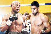 Khan Calls Chicken to Mayweather