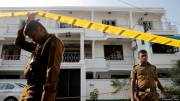 Sri Lanka lowers Easter attack death toll while suspects still at large