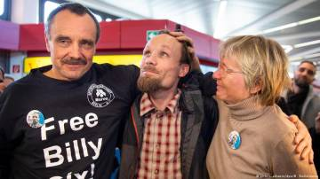 Journalist Billy Six arrives in Germany, slams government