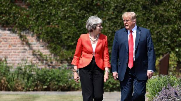 Donald Trump and Theresa May commit to free trade agreement, dismiss tabloid interview