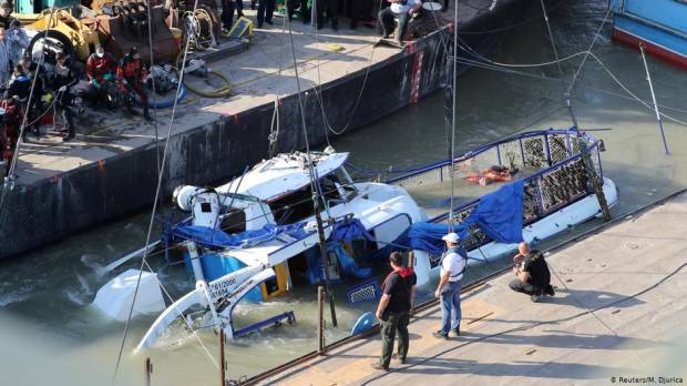 Police in Hungary lift capsized tourist boat from Danube