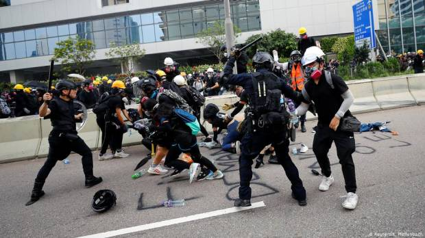 Hong Kong protests: Police fire tear gas in renewed flair of violence